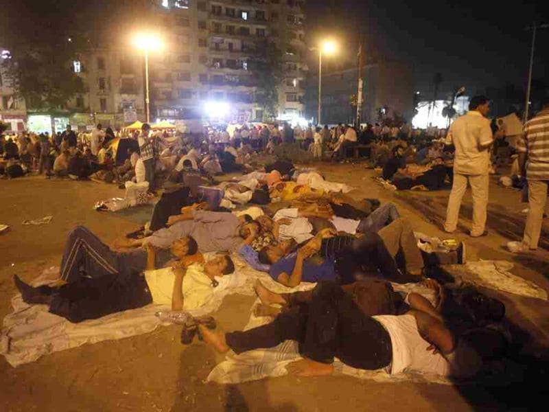 Protesters sleep during a sit-in at Tahrir Square in Cairo. The Muslim Brotherhood called for a sit-in at Tahrir Square and other squares across the country to step up pressure against the military council as Egyptians await the result for the presidential elections which could come in a few days' time. REUTERS/Asmaa Waguih