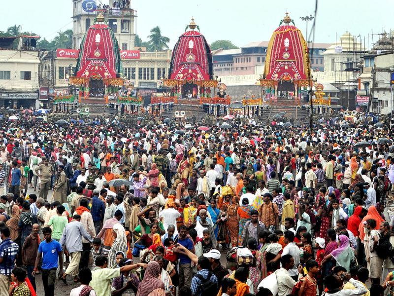 Devotees throng around the chariots as they wait to pull them during the annual Hindu festival