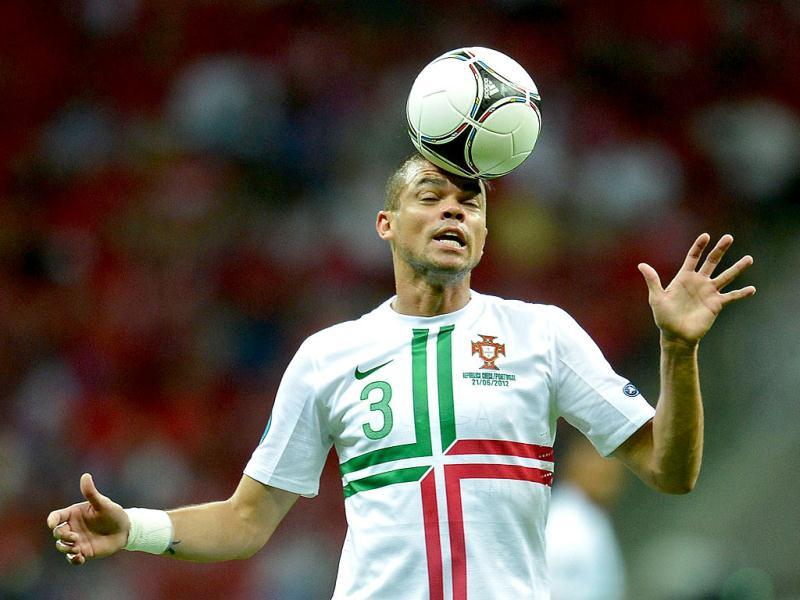 Portuguese defender Pepe heads the ball during the Euro 2012 football championships quarter-final match the Czech Republic vs Portugal at the National Stadium in Warsaw. AFP/Francisco Leong