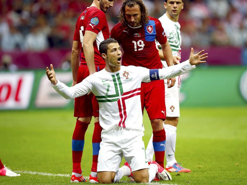 Portugal's Cristiano Ronaldo (C) reacts in front of Czech Republic's Petr Jiracek during their Euro 2012 quarter-final soccer match at the National stadium in Warsaw. Reuters/Kai Pfaffenbach
