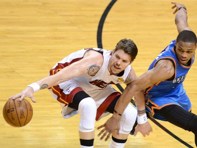 Mike Miller (L) of the Miami Heat is guarded by Russell Westbrook (R) of the Oklahoma City Thunder during Game 5 of the NBA finals at the American Airlines Arena in Miami, Florida.  AFP/Don Emmert