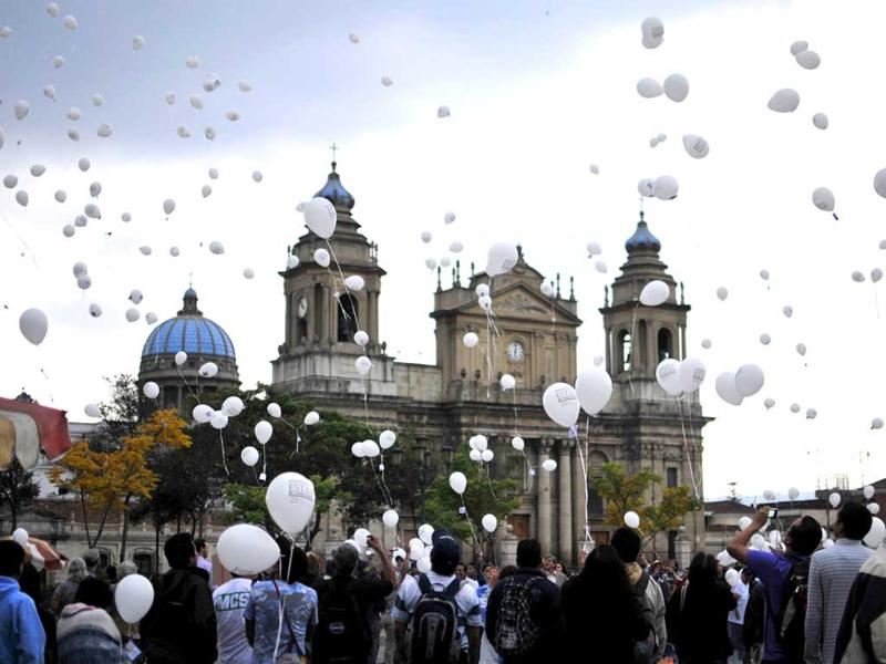 People release balloons during a ceremony marking the commemoration of the National Day on Enforced Disappearances held in Guatemala City. AFPO/Luis Soto