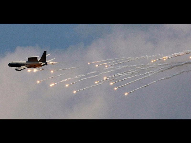 A South Korean Air Forces' E-737 Peace-Eye aircraft fires flare shells during a South Korea-US joint military live-fire drills at Seungjin Fire Training Field in Pocheon, South Korea, near the border with the North Korea. The drills were held in a show of combat readiness ahead of the 62nd anniversary of the start of the Korean War on June 25. (AP Photo/Lee Jin-man)