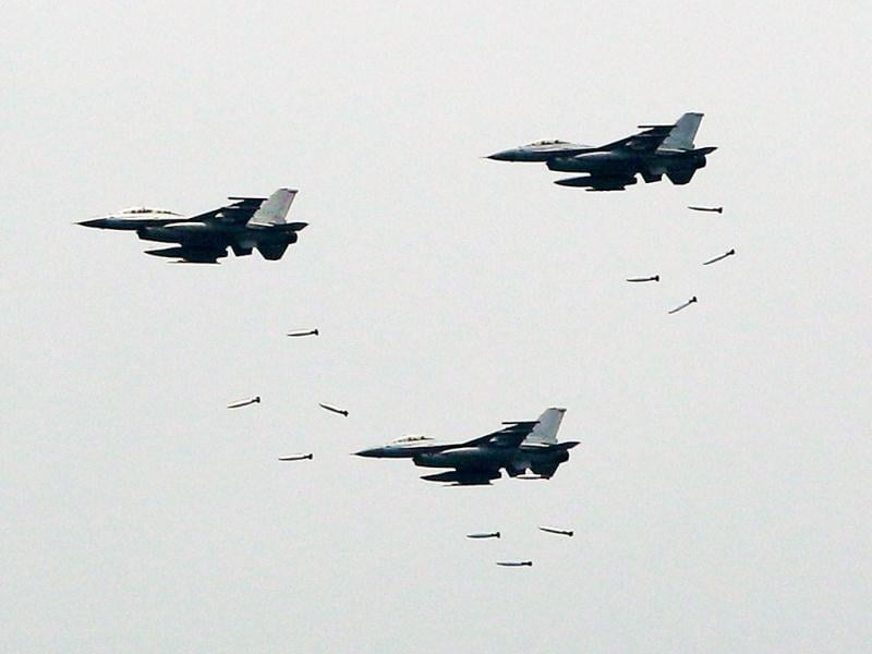 South Korean Air Forces' KF-16 fighters drop bombs during a South Korea-US joint military live-fire drills at Seungjin Fire Training Field in Pocheon, South Korea, near the border with the North Korea. The drills were held in a show of combat readiness ahead of the 62nd anniversary of the start of the Korean War on June 25. (AP Photo/Lee Jin-man)