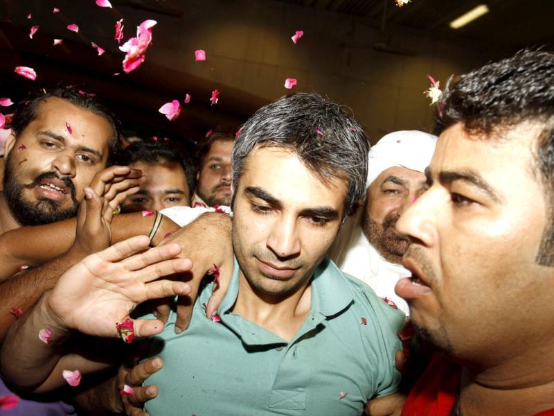 Pakistani cricket fans receive former Pakistani cricket captain Salman Butt upon his arrival from England at Lahore airport, Pakistan. AP/KM Chaudary