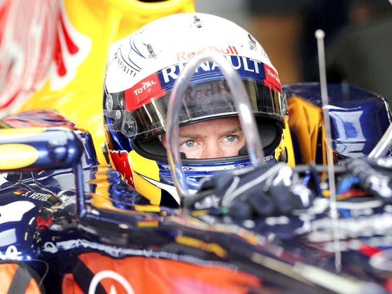 Red Bull Formula One driver Sebastian Vettel of Germany sits in his car during the first practice session of the European F1 Grand Prix at the Valencia street circuit. Reuters/Albert Gea