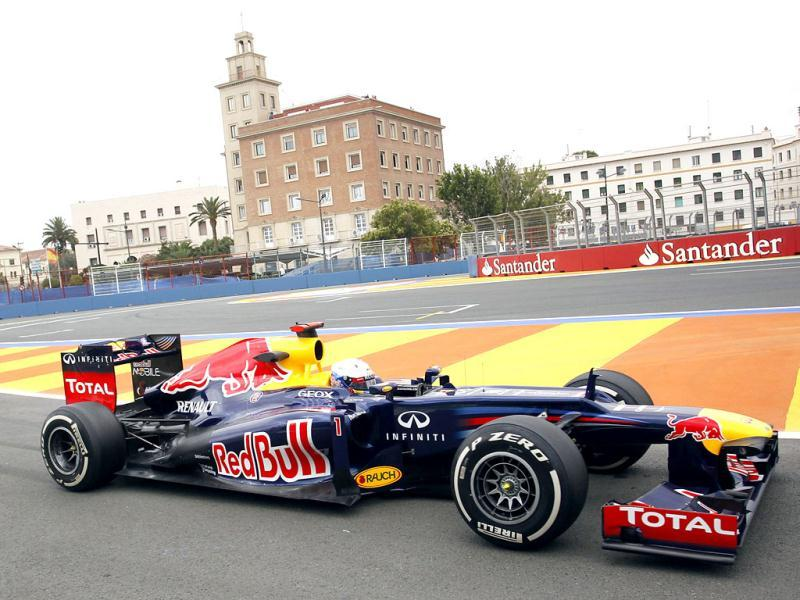 Red Bull driver Sebastian Vettel of Germany steers his car during a test session at Valencia street circuit, Spain. The race European Formula One Grand Prix will take place over the street circuit surrounding the city's port. AP Photo/Alberto Saiz