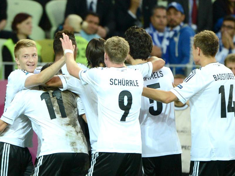 German defender Philipp Lahm (hidden) celebrates with teammates after scoring during the Euro 2012 football championships quarter-final match Germany vs Greece at the Gdansk Arena.(AFP Photo/Ane-Christine Poujoulat)