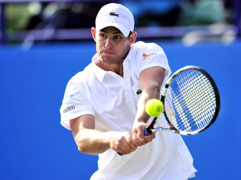 Andy Roddick of the US returns the ball to Steve Darcis of Belgium during his men's semi-final singles match on the seventh day of the AEGON International tennis tournament in Eastbourne, southern England. AFP/Glyn Kirk