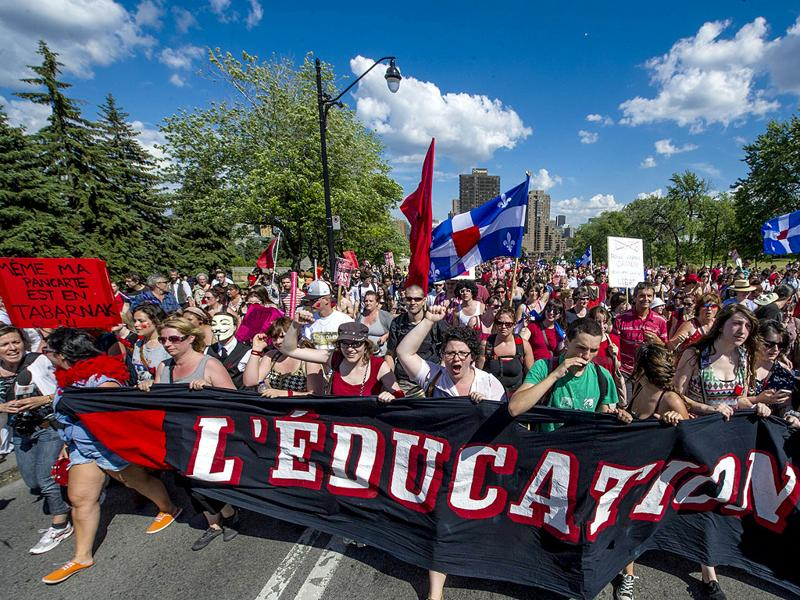 Students protest a hike in tuition fees in Montreal, Canada. After two weeks of relative calm, tens of thousands of students were back on the streets to protest the rising university fees, now in its fifth month. AFP/Rogerio Barbosa
