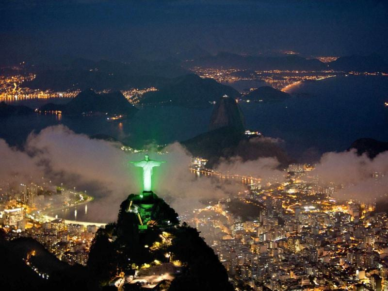 An aerial view of Christ the Redeemer statue is lit up in green in Rio de Janeiro. Reuters/Siemens