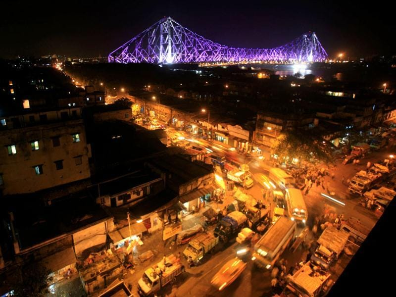 Traffic moves during the evening as the Howrah Bridge is lit up in the background in the eastern Indian city of Kolkata. Reuters/Jayanta Shaw