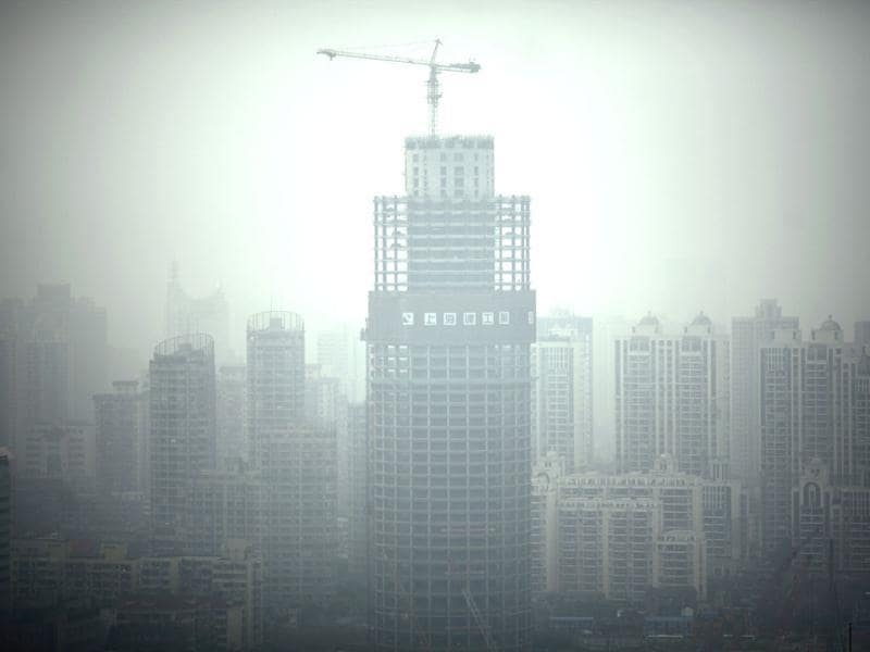 A view of downtown Shanghai on a hazy day is seen. Reuters/Carlos Barria