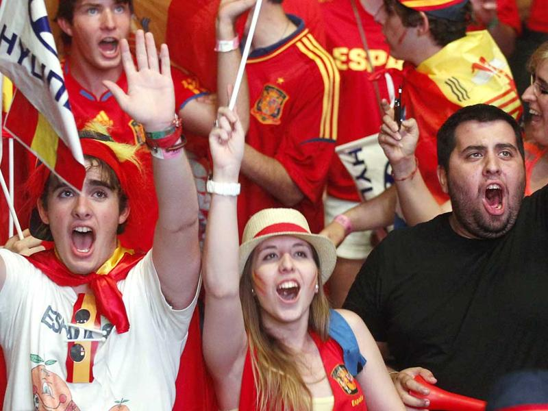 Supporters celebrate Spain's victory after their Euro 2012 quarter-final soccer match against France at a fan mile in Madrid. REUTERS/Andrea Comas