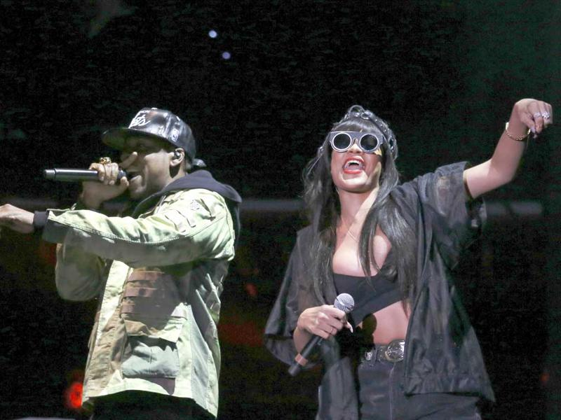 Jay Z (L) performs, with a surprise appearance from Rihanna, at the Hackney Weekender festival at Hackney Marshes in east London. REUTERS/Olivia Harris