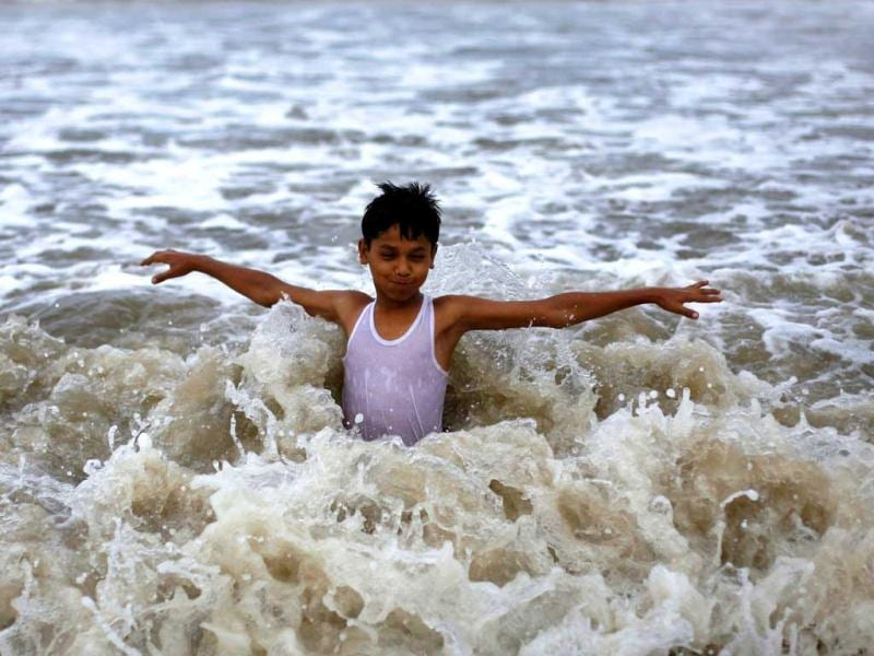 A boy plays in the waters of the Arabian Sea as it drizzles during a pre-monsoon shower in Mumbai. The India Meteorological Department (IMD) has forecast average rainfall for the whole June to September. Reuters/Vivek Prakash