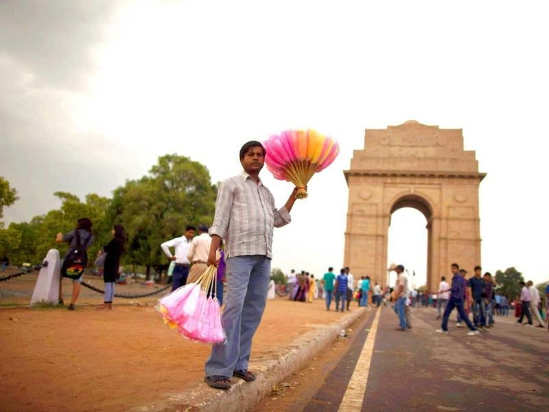 A vendor holds candies for sale in front of the India Gate against the backdrop of pre-monsoon clouds in New Delhi. The India Meteorological Department (IMD) has forecast average rainfall for the whole June to September. Reuters/Ahmad Masood