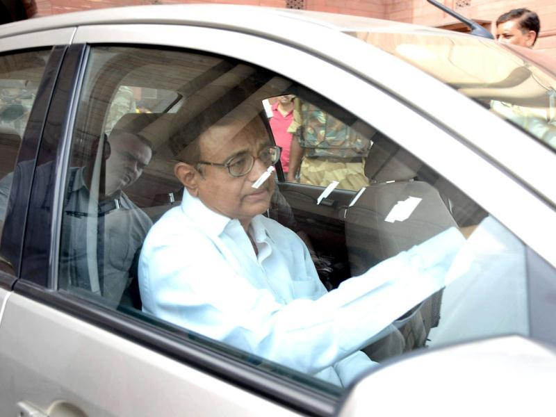 Union home minister P Chidambaram driving his car after inspecting the fire which broke out at the second floor of the home ministry in North Block in New Delhi. HT Photo