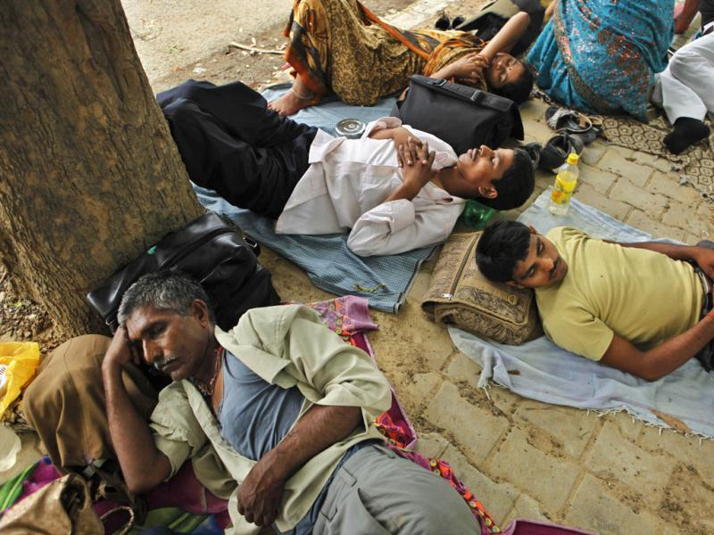 Villagers sleep in the shade of a tree on a hot summer day in Allahabad. AP/Rajesh Kumar Singh