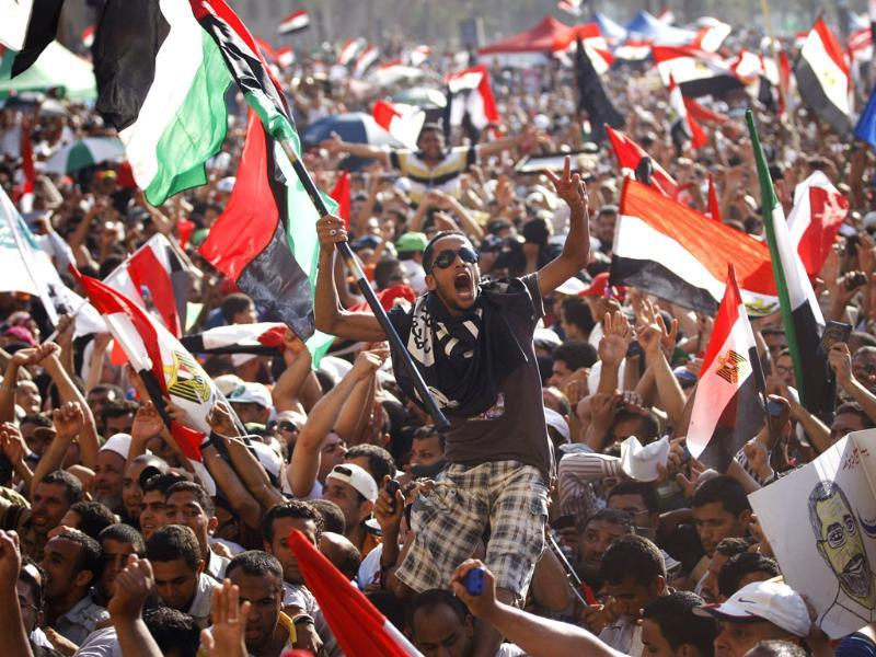 Egyptian protesters celebrate the victory of Mohammed Morsi, in the country's presidential election, in Tahrir Square in Cairo.(AP Photo/Khalil Hamra)