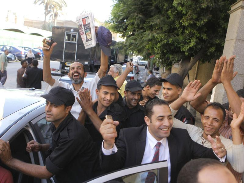 Egyptians celebrate the results if the Presidential election in Cairo, Egypt. (AP Photo/Amr Nabil)