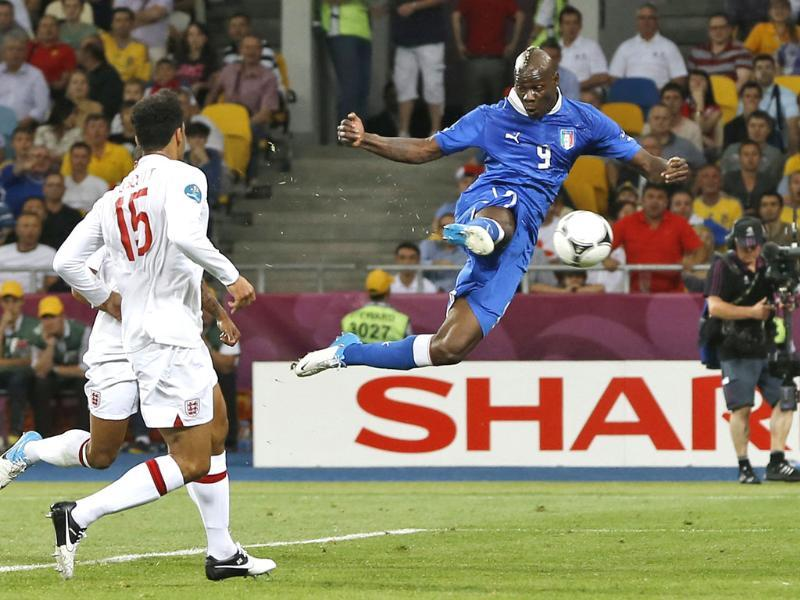 Italy's Mario Balotelli shoots by England's Joleon Lescott during the Euro 2012 soccer championship quarterfinal match between England and Italy in Kiev, Ukraine. (AP Photo/Kirsty Wigglesworth)
