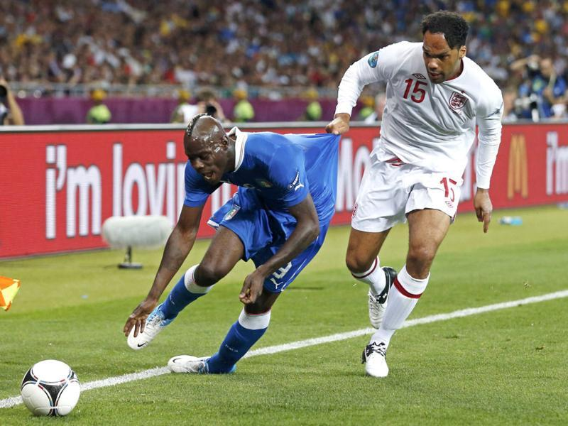 England's Joleon Lescott (R) fouls Italy's Mario Balotelli during their Euro 2012 quarter-final soccer match at Olympic Stadium in Kiev. (Reuters/Eddie Keogh)