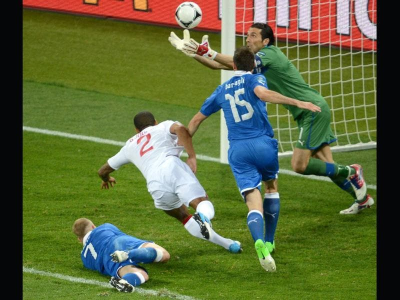 Italian goalkeeper Gianluigi Buffon (TopR) catches the ball during the Euro 2012 football championships quarter-final match England vs Italy at the Olympic Stadium in Kiev. (AFP photo/ Jeff Pachoud)