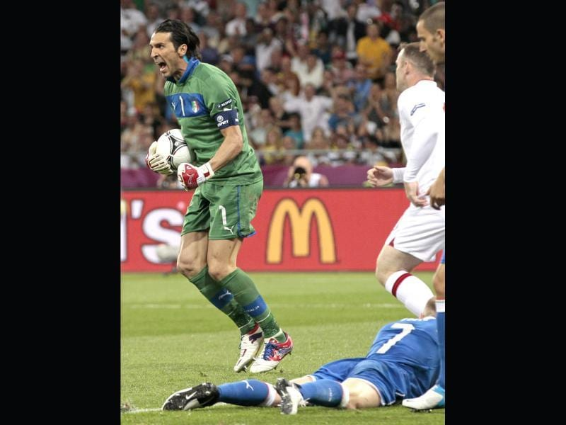 Italy goalkeeper Gianluigi Buffon reacts after making a save during the Euro 2012 soccer championship quarterfinal match between England and Italy in Kiev, Ukraine. (AP Photo/Ivan Sekretarev)
