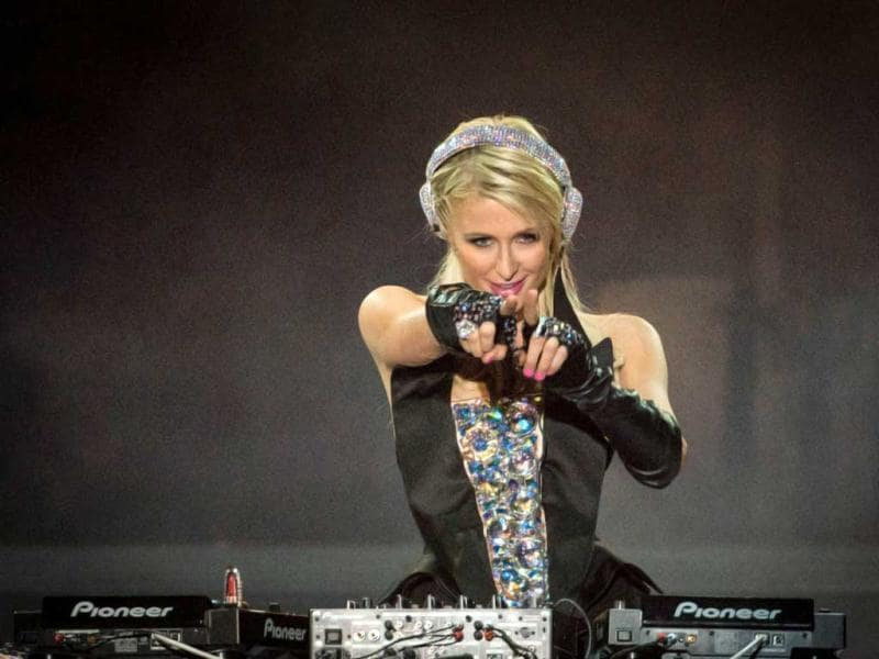 She's a businesswoman, a socialite, a model, a producer, a fashion designer and now she's turned DJ too. Here's a look at Hilton rock Brazil. (AFP Photo)