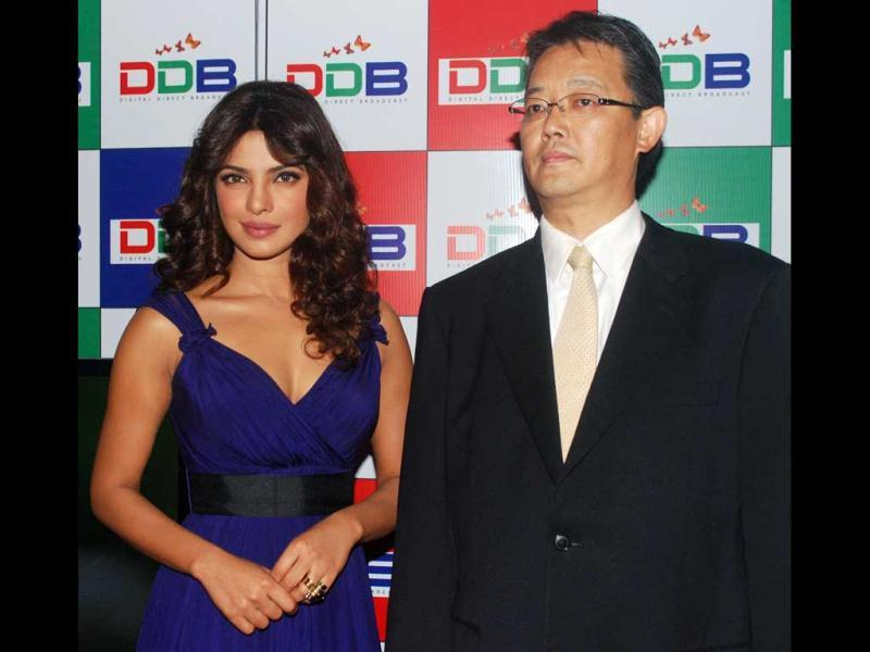 Bollywood star and brand ambassador Priyanka Chopra along with Kohyama, vice president DDB doundation during the launch of Digital Direct Broadcast (DDB),the world's first digital entertainment platforms on the Indian television sets, in Mumbai on Monday.