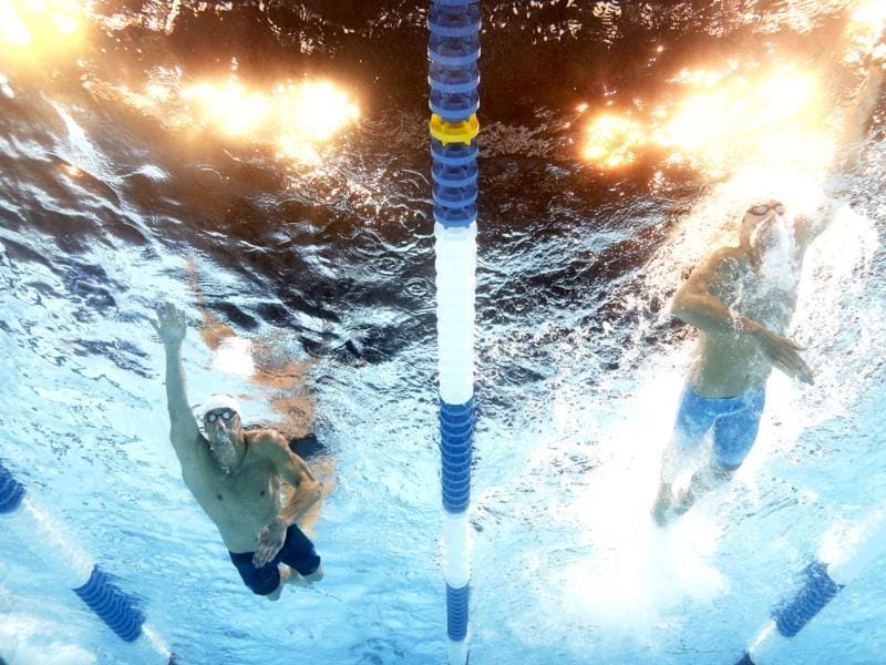 Michael Phelps and Conor Dwyer swim in the men's 200-meter freestyle preliminaries at the US Olympic swimming trials in Omaha, Nebraska. AP/Mark J. Terrill