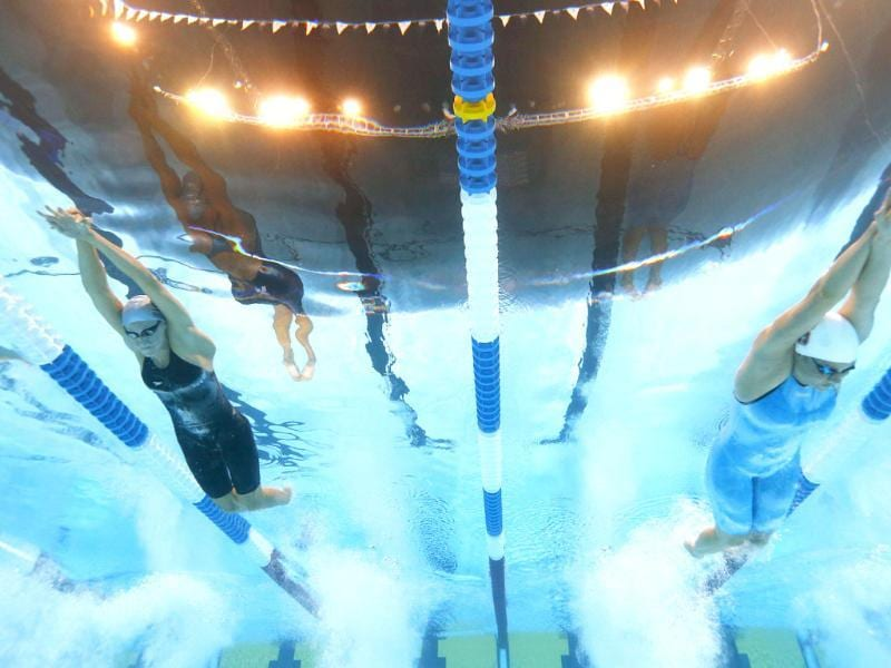 Dana Vollmer and Elaine Breeden swim in the women's 100-meter butterfly semifinals at the US Olympic swimming trials, in Omaha, Nebraska. AP/David Phillip
