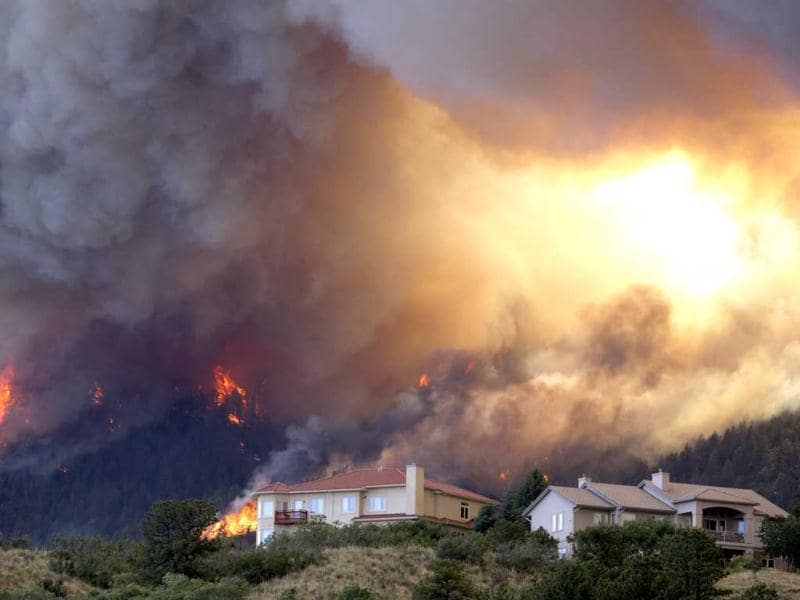 Fire from the Waldo Canyon wildfire as it moved into subdivisions and destroyed homes in Colorado Springs. AP/Gaylon Wampler