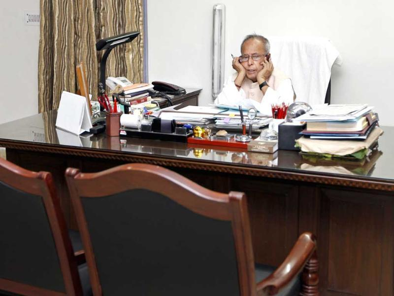 UPA Presidential candidate Pranab Mukherjee finishes work at home after his resignation as finance minister, in New Delhi. HT/Ajay Aggarwal