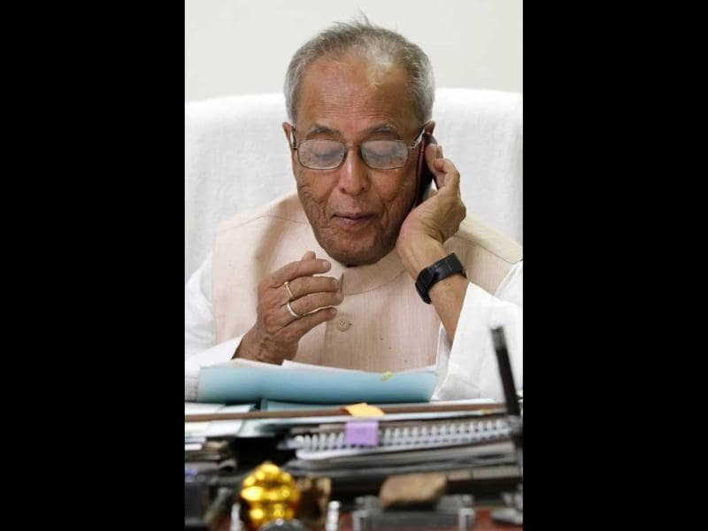 UPA Presidential candidate Pranab Mukherjee replies to phone calls at the office space in his residence in New Delhi. HT/Gurinder Osan