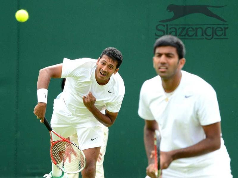 Mahesh Bhupathi serves during his first round men's doubles match with Rohan Bopanna (R) against Uruguay's Marcel Feldeon and Tunisia's Malek Jaziri on day three of the 2012 Wimbledon Championships tennis tournament at the All England Tennis Club in Wimbledon, southwest London. AFP/Leon Neal