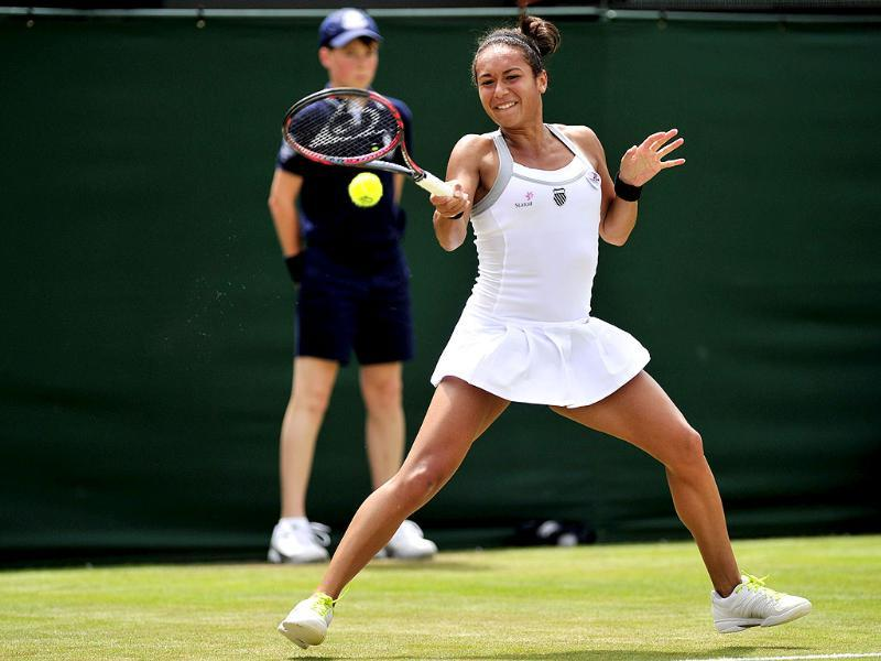Britain's Heather Watson plays a forehand shot during her second round women's singles victory over US player Jamie Lee Hampton on day three of the 2012 Wimbledon Championships tennis tournament at the All England Tennis Club in Wimbledon, southwest London. AFP/Glyn Kirk