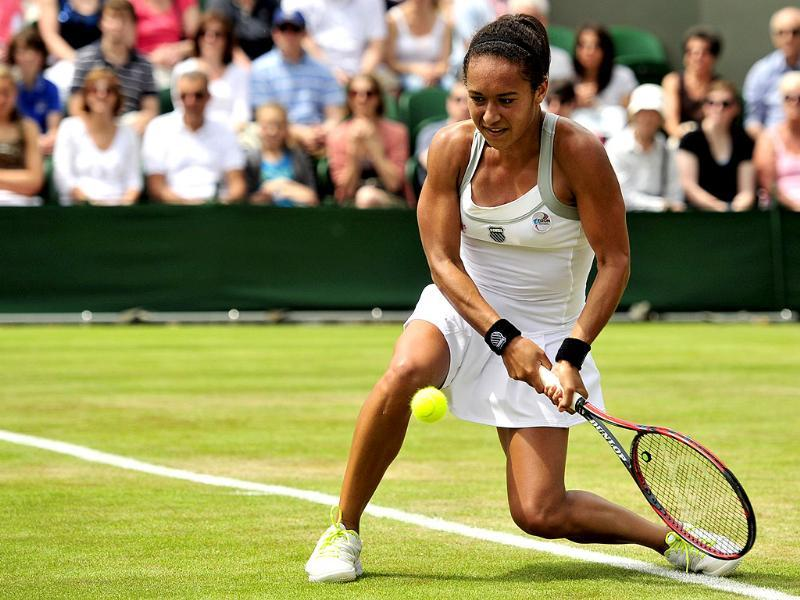 Britain's Heather Watson plays a double-handed backhand shot during her second round women's singles victory over US player Jamie Lee Hampton on day three of the 2012 Wimbledon Championships tennis tournament at the All England Tennis Club in Wimbledon, southwest London. AFP/Glyn Kirk