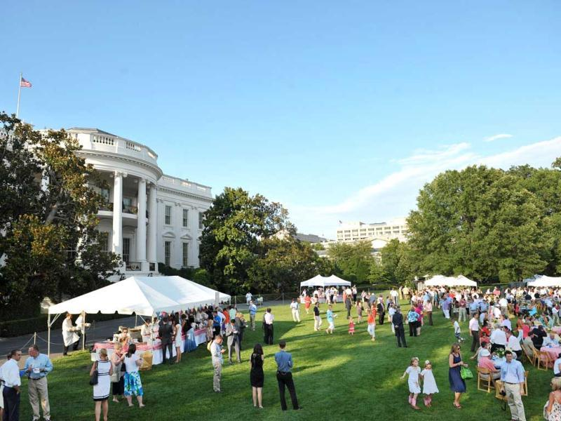 This general view shows the annual picnic for Members of Congress on the South Lawn of the White House in Washington, DC. AFP Photo/Mandel Ngan