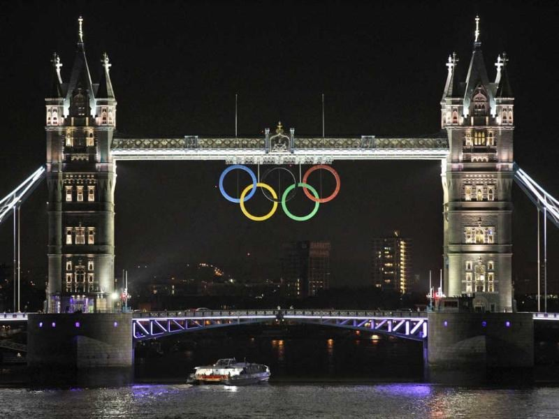 The Olympic rings are seen atop the iconic Tower Bridge over river Thames in London, coinciding with one month to go until the start of the London 2012 Games. The giant rings, which are fully retractable to allow for tall ships to pass through the bridge, will remain in position for the duration of the Games. AP Photo/Lefteris Pitarakis