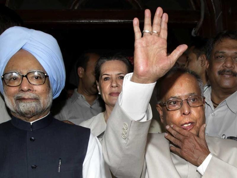 Pranab Mukherjee waves while exiting Parliament house with Prime Minister Manmohan Singh and Congress party president Sonia Gandhi after filing his nomination as the presidential candidate of the UPA in New Delhi. AP/Manish Swarup