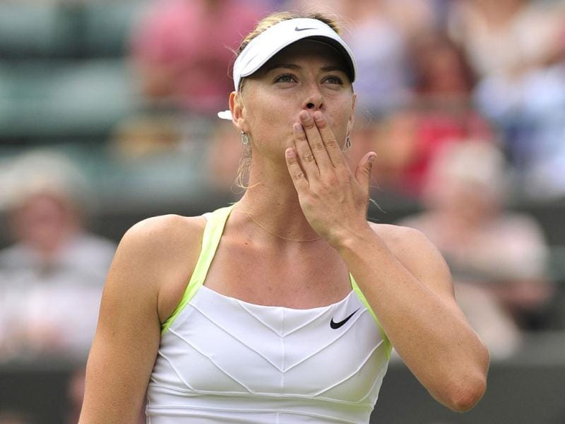 Russia's Maria Sharapova gestures after her second round women's singles victory over Bulgaria's Tsvetana Pironkova on day four of the 2012 Wimbledon Championships in London. AFP Photo/Glyn Kirk