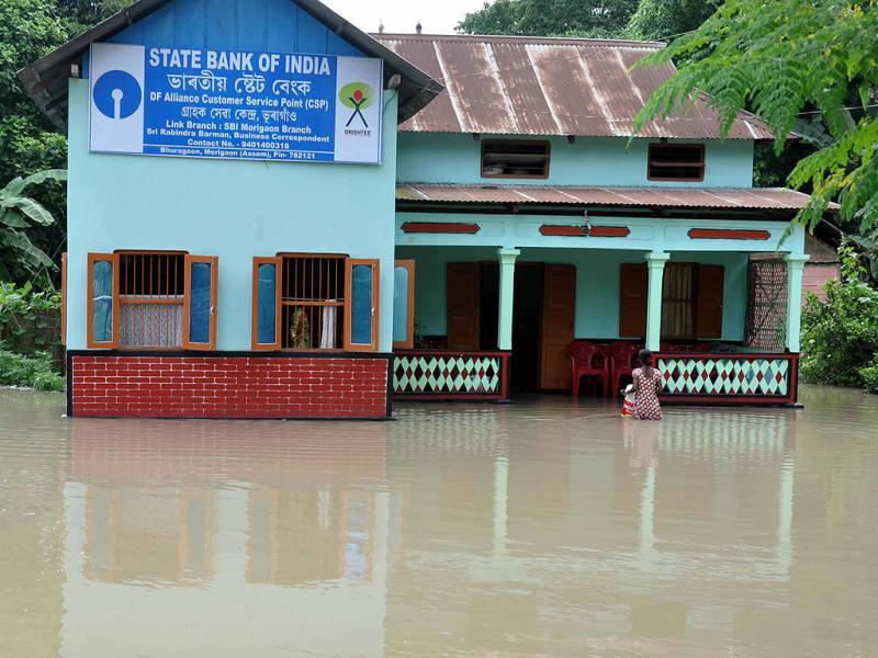 A State Bank of India branch office isolated by floods at Bhuragaon, Marigaon district of Assam. (UNI Photo)