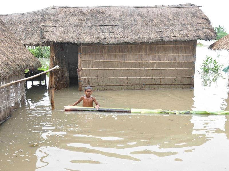 Submerged huts in the flood affected village Kushena in Marigaon district of Assam. (UNI Photo)