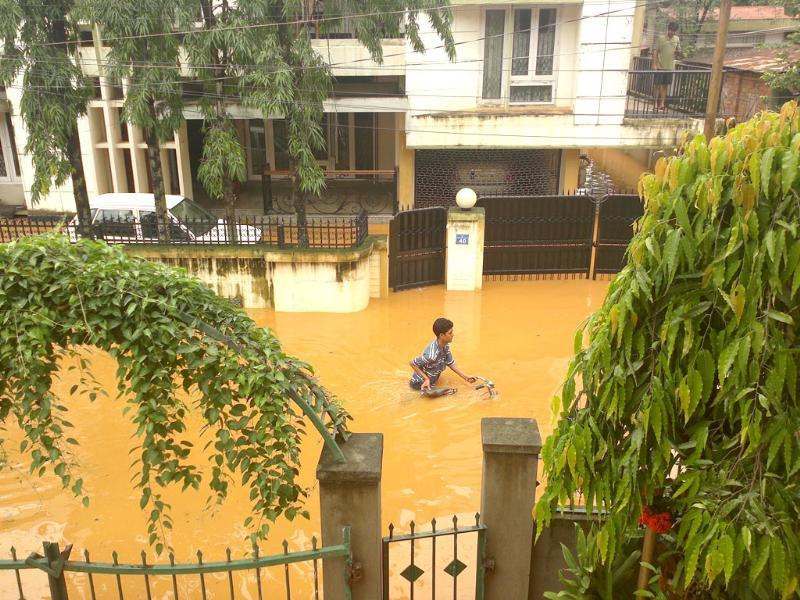 A man walks his bicycle along a flooded Assam street. Photo by Parswa D Nair, advocate in Guwahati high court