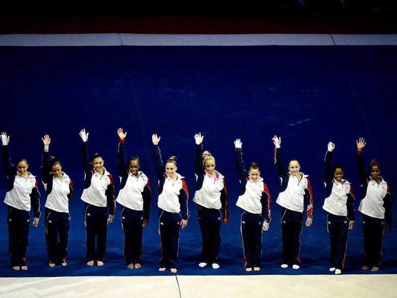 Competitors wave during day 2 of the 2012 US Olympic Gymnastics Team Trials at HP Pavilion in San Jose, California. Ronald Martinez