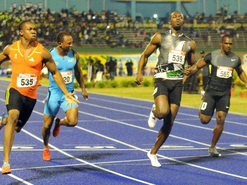 World champion Yohan Blake celebrates after crossing the finish line ahead of current world-record holder Usain Bolt, second from right, Nesta Carter and Michael Frater to win the 100m final at Jamaica's Olympic trials in Kingston, Jamaica. AP/Collin Reid