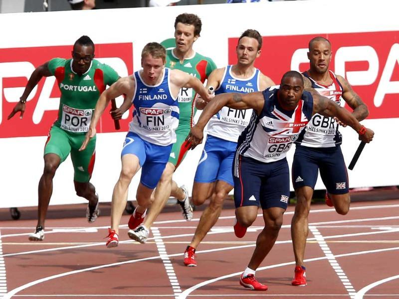 The teams of Portugal, Finland and Britain are seen during the last exchange of the baton during the men's 4x100 metres relay semi-finals at the European Athletics Championships in Helsinki. Reuters/Laszlo Balogh