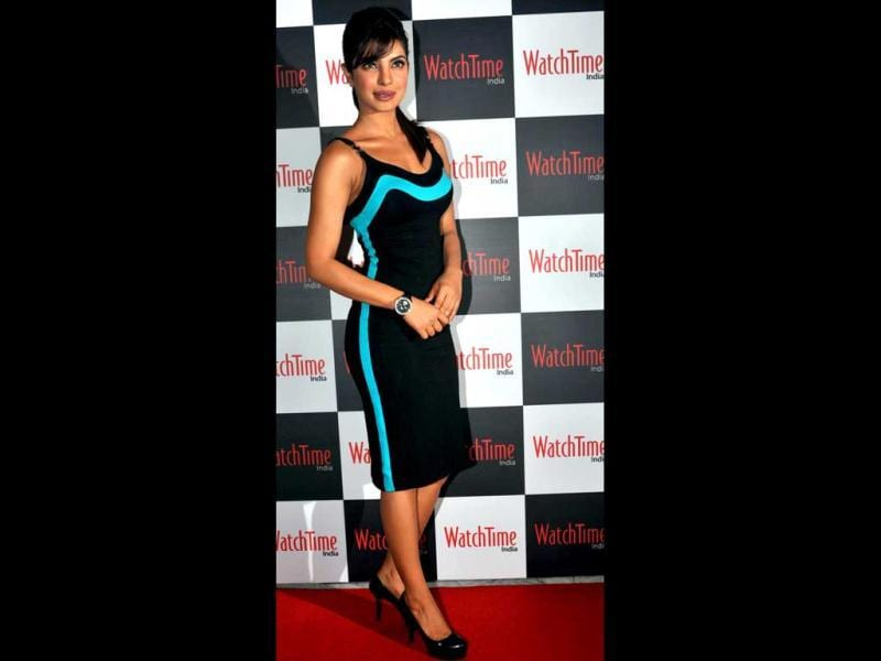 The Versace knee-length black dress Priyanka Chopra wore for the launch of WatchTime India magazine, did not do much for her. Is she losing her fashion sense? (AFP photo)
